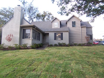 Picture of home with multiple additions, rolling lawn, bushes and trees - Little Rock Rentals