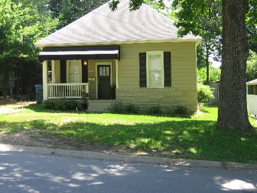 Cute home with small front porch overlooking beautiful lawn, plenty of natural light and large windows - Little Rock House Rentals